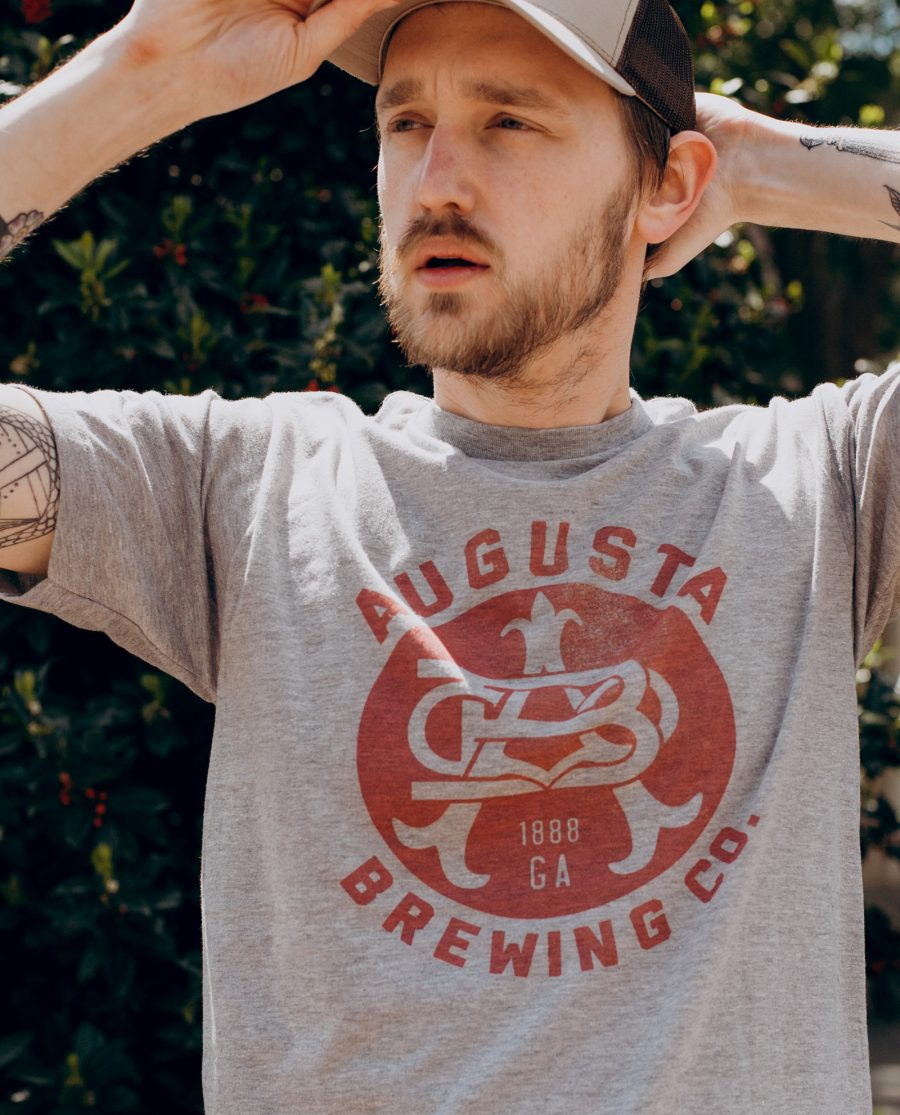 Man wearing gray Augusta Brewing shirt