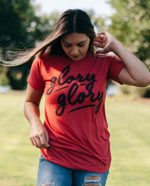Woman wearing red Glory Glory shirt with jeans