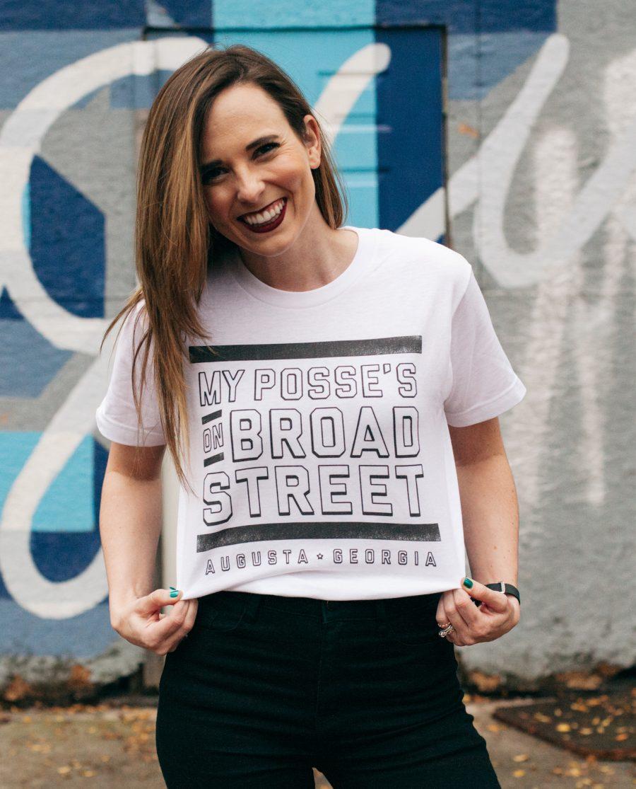 Woman wearing white Posse on Broad Street shirt