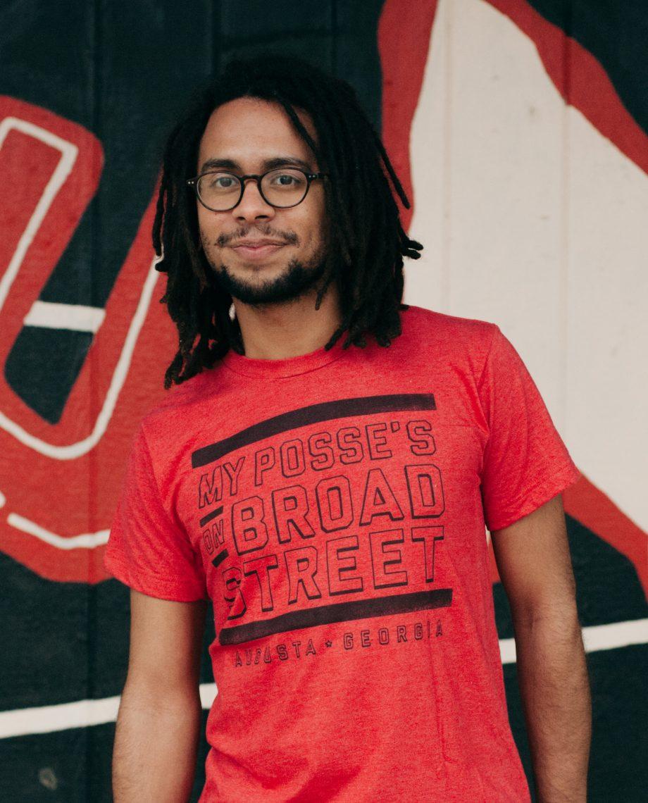 Man wearing red Posse on Broad Street shirt