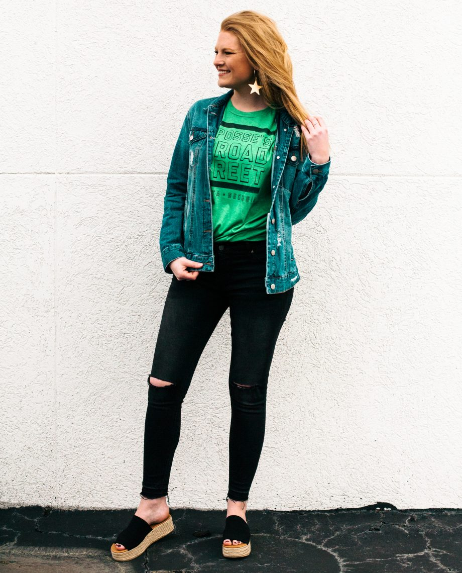 Woman wearing green Posse on Broad Street with black jeans
