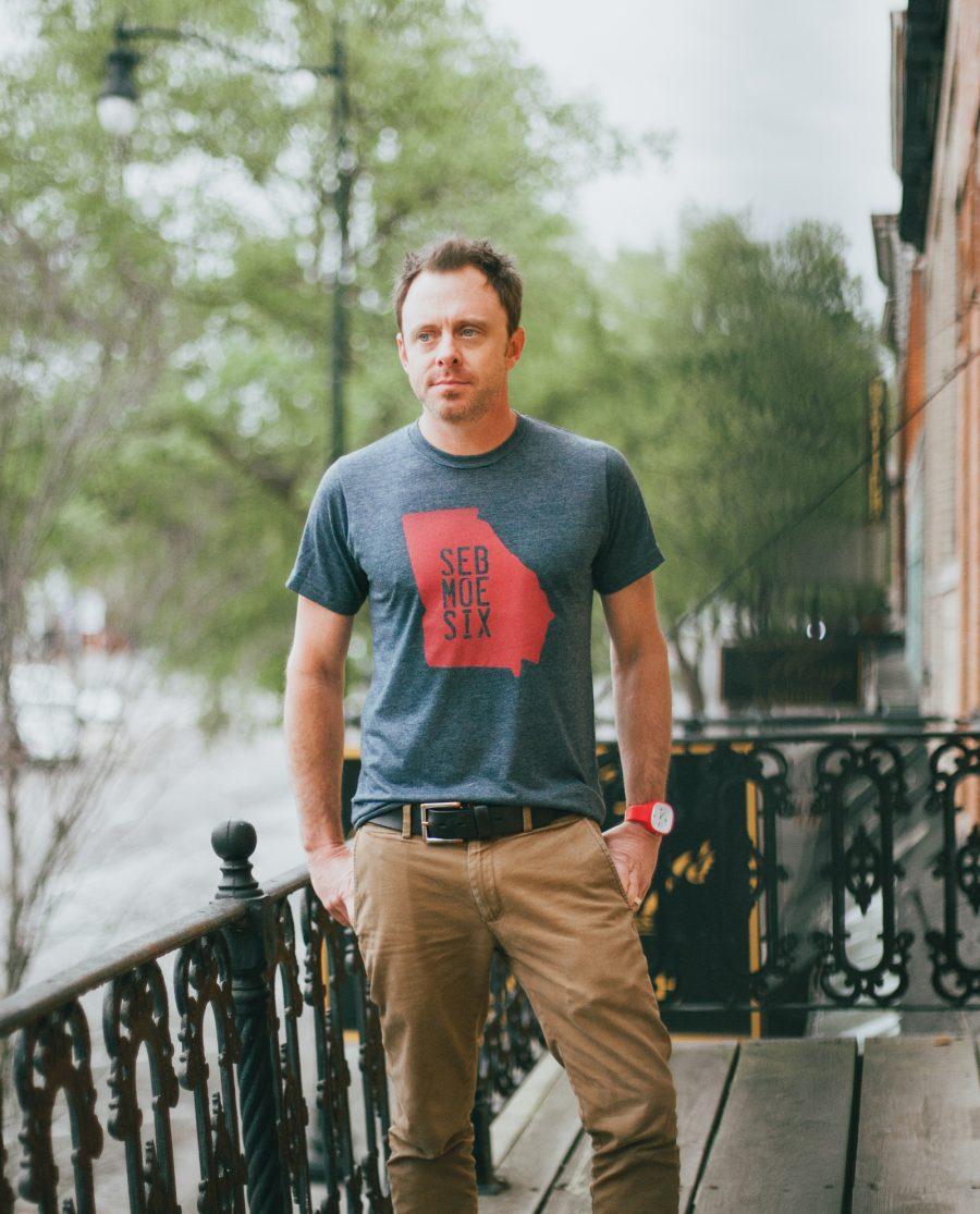 Man on downtown porch wearing blue Seb Moe Six