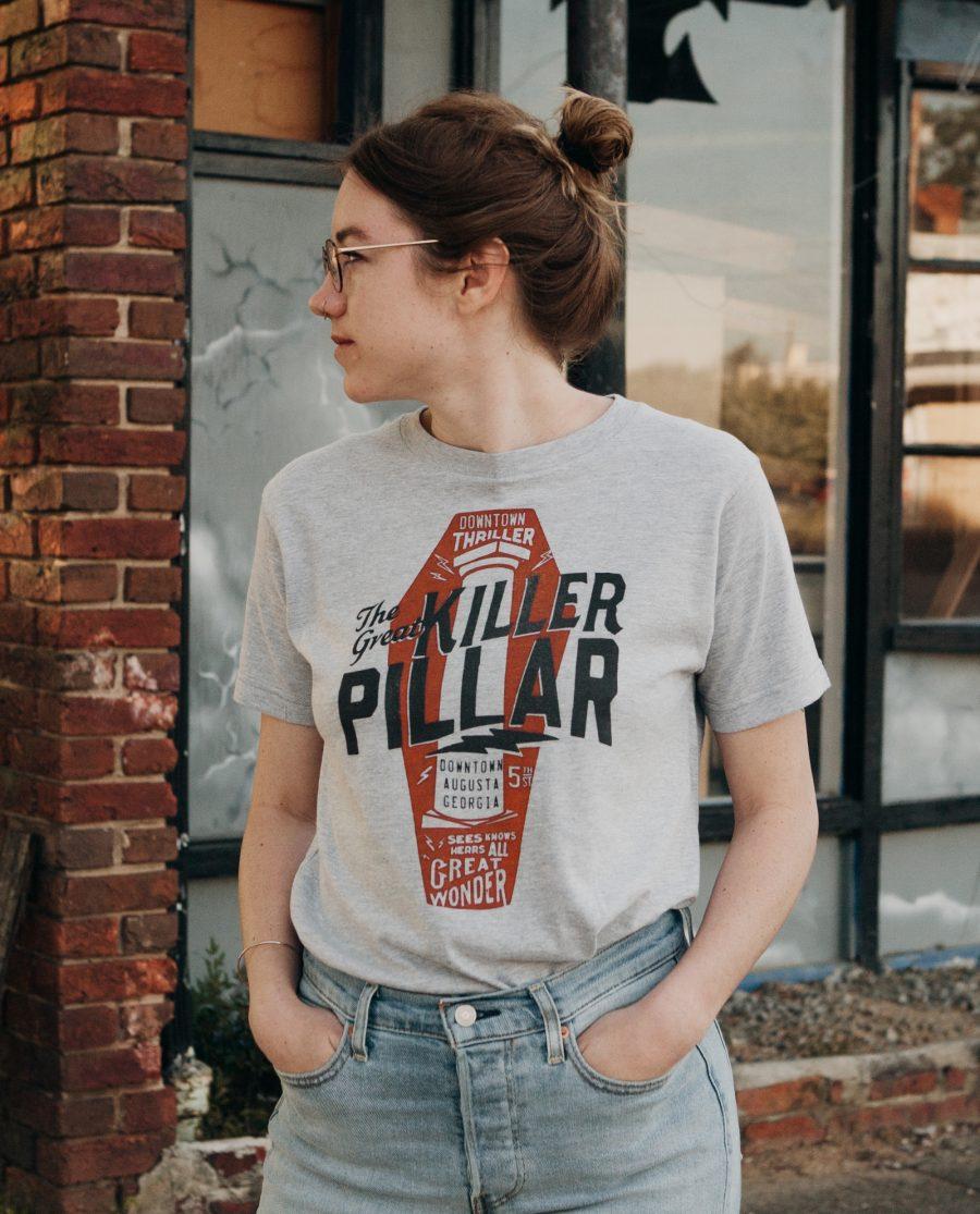 Woman looking to the side wearing gray Killer Pillar shirt