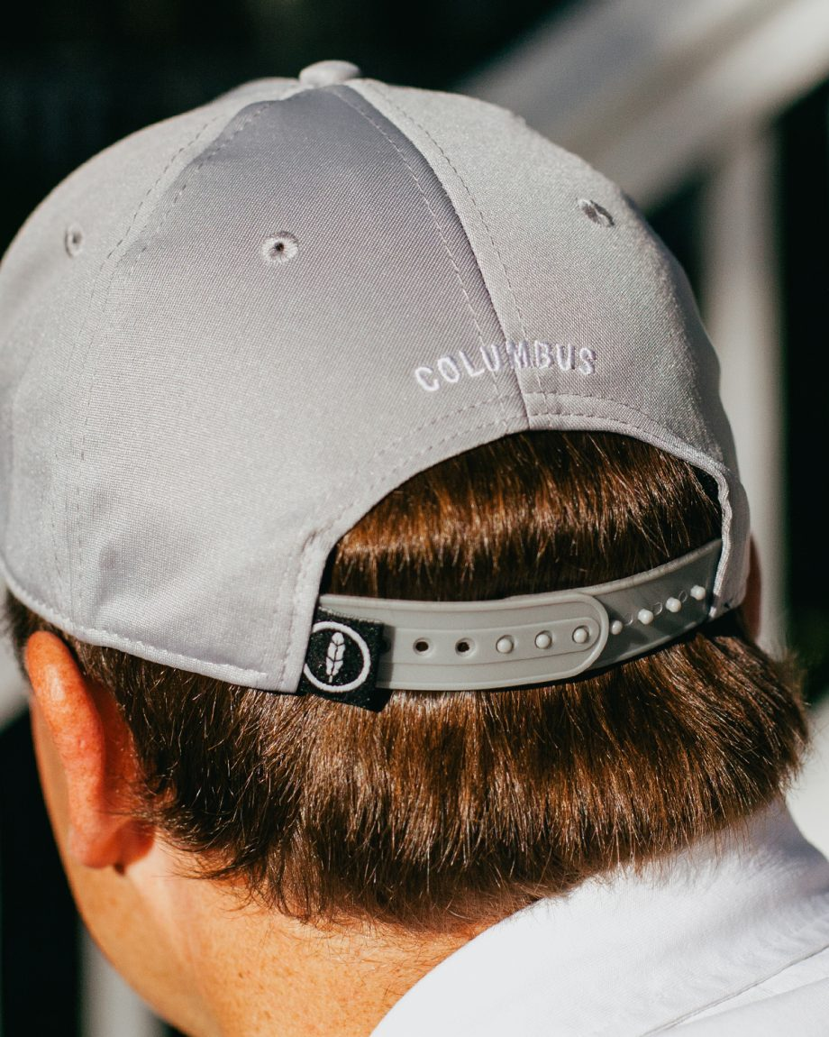 Man wearing gray 1870 Columbus Ohio feather fit hat