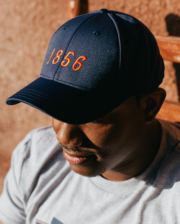 Man wearing navy and orange 1856 Auburn Alabama feather fit hat