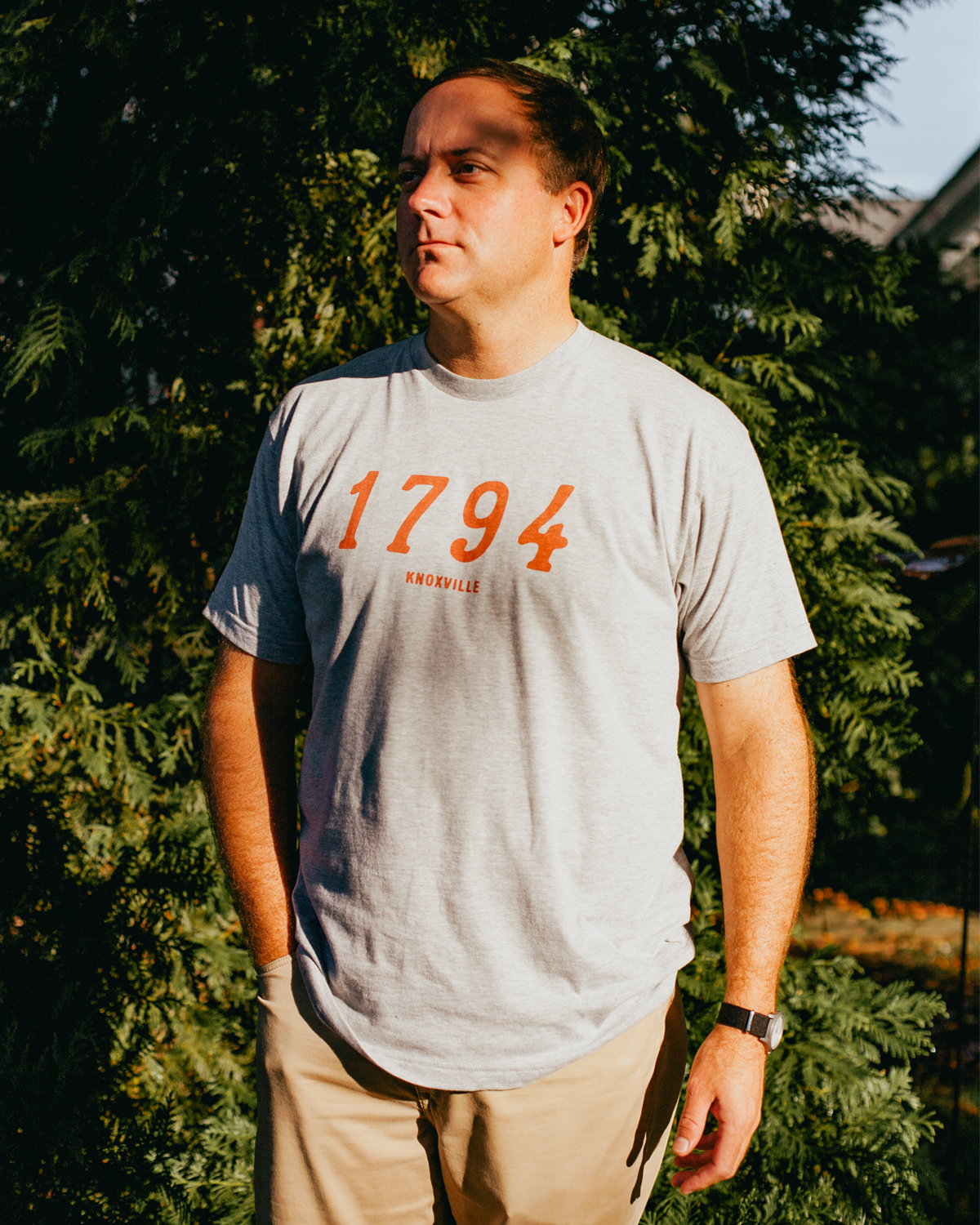 Man wearing 1794 Knoxville Tennessee shirt with khakis