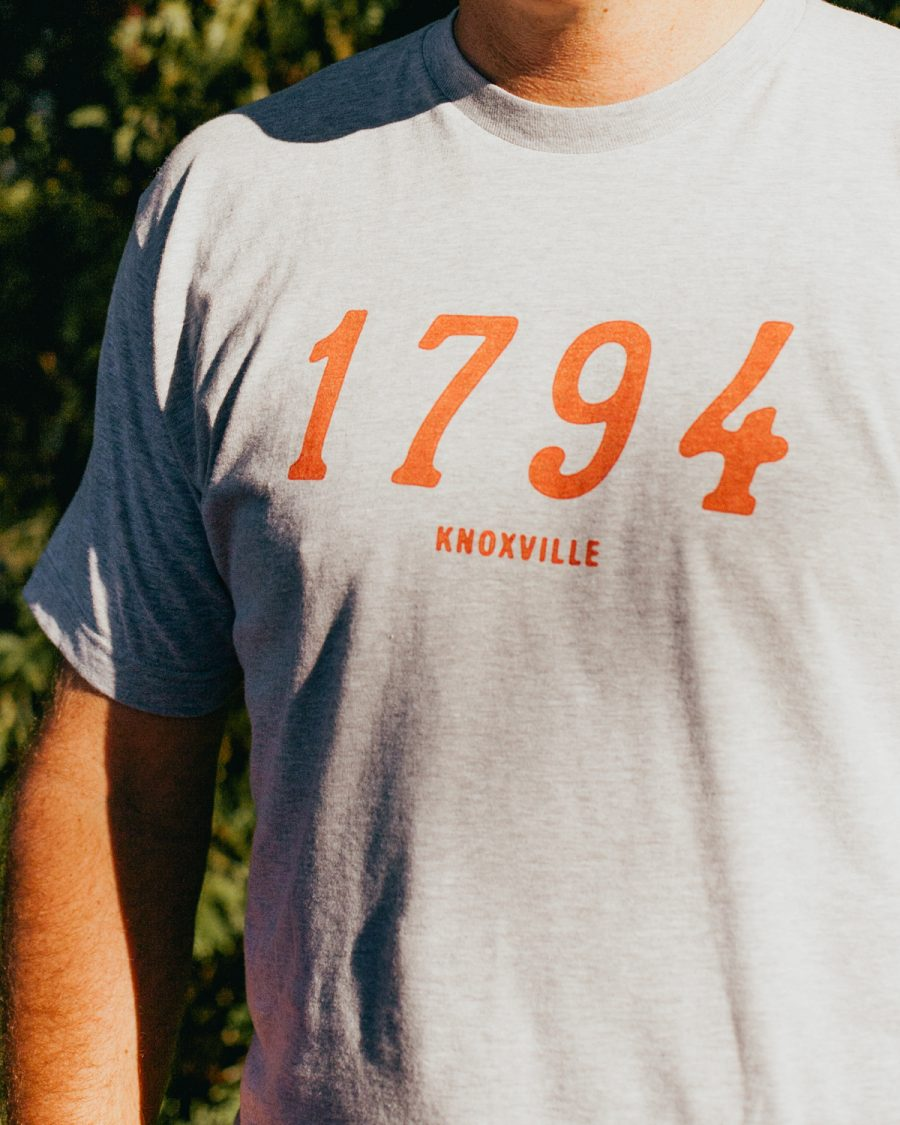 Man wearing gray 1794 Knoxville Tennessee shirt