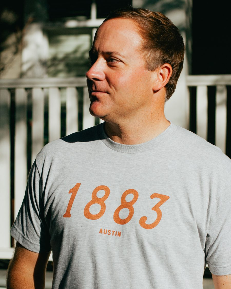 Man wearing gray 1883 Austin Texas shirt