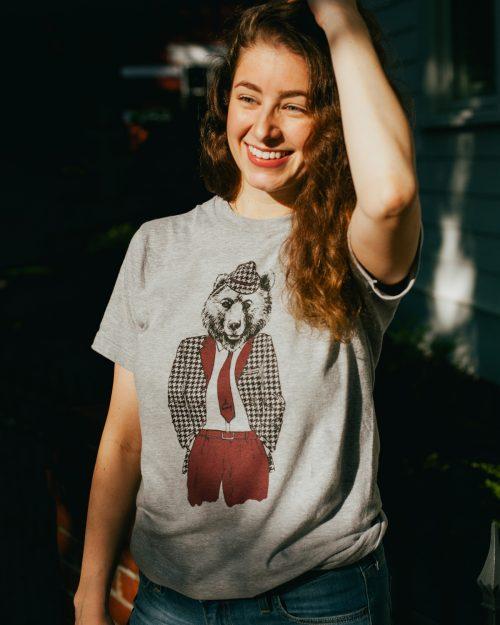 Woman wearing gray Ole Bamy shirt