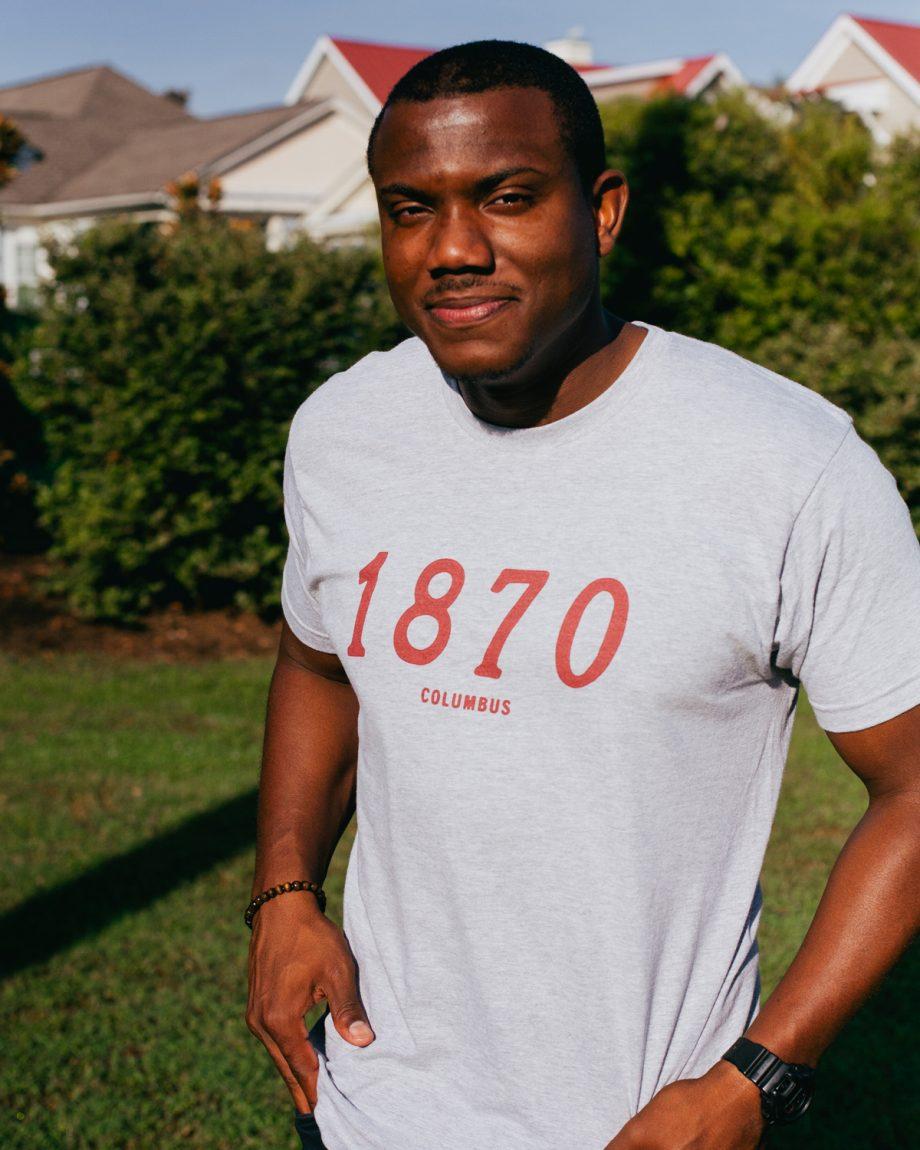 Man wearing gray 1870 Columbus Ohio shirt