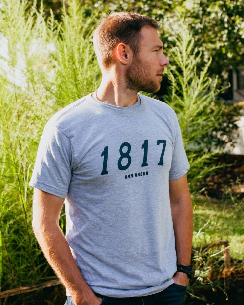 Man wearing gray 1817 Ann Arbor Michigan shirt