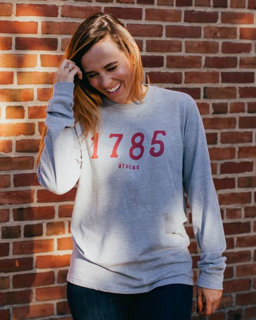 Woman wearing gray long sleeve 1785 Athens Georgia shirt