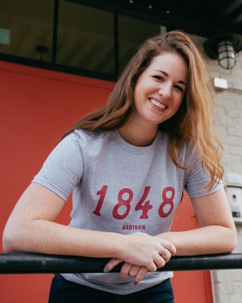 Woman wearing gray 1848 Madison Wisconsin shirt