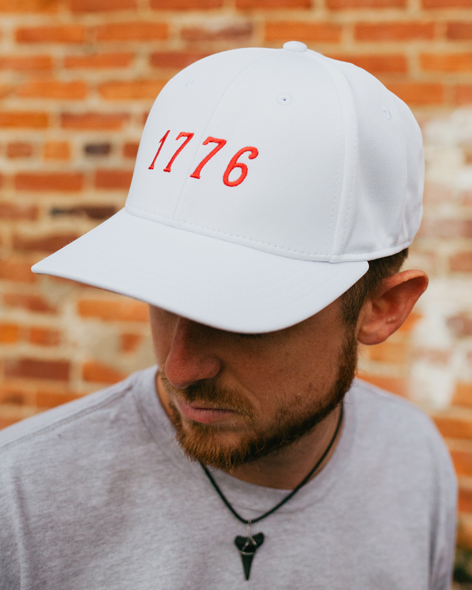 Man wearing white 1776 USA feather fit hat