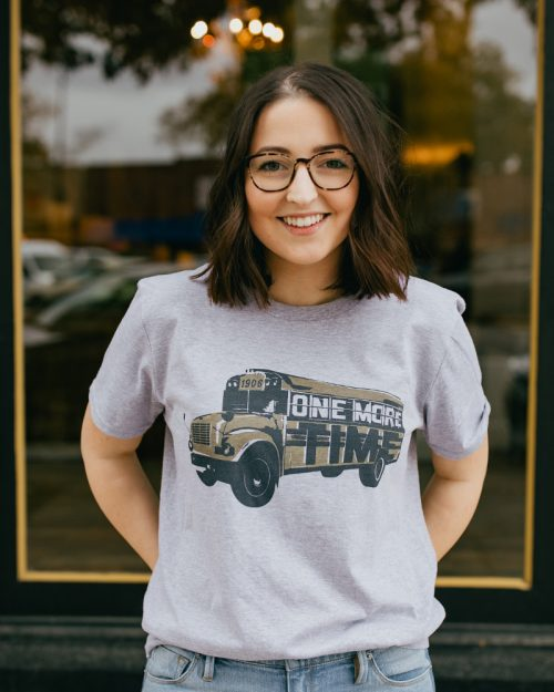 Woman wearing a gray Statesboro Georgia One More Time shirt
