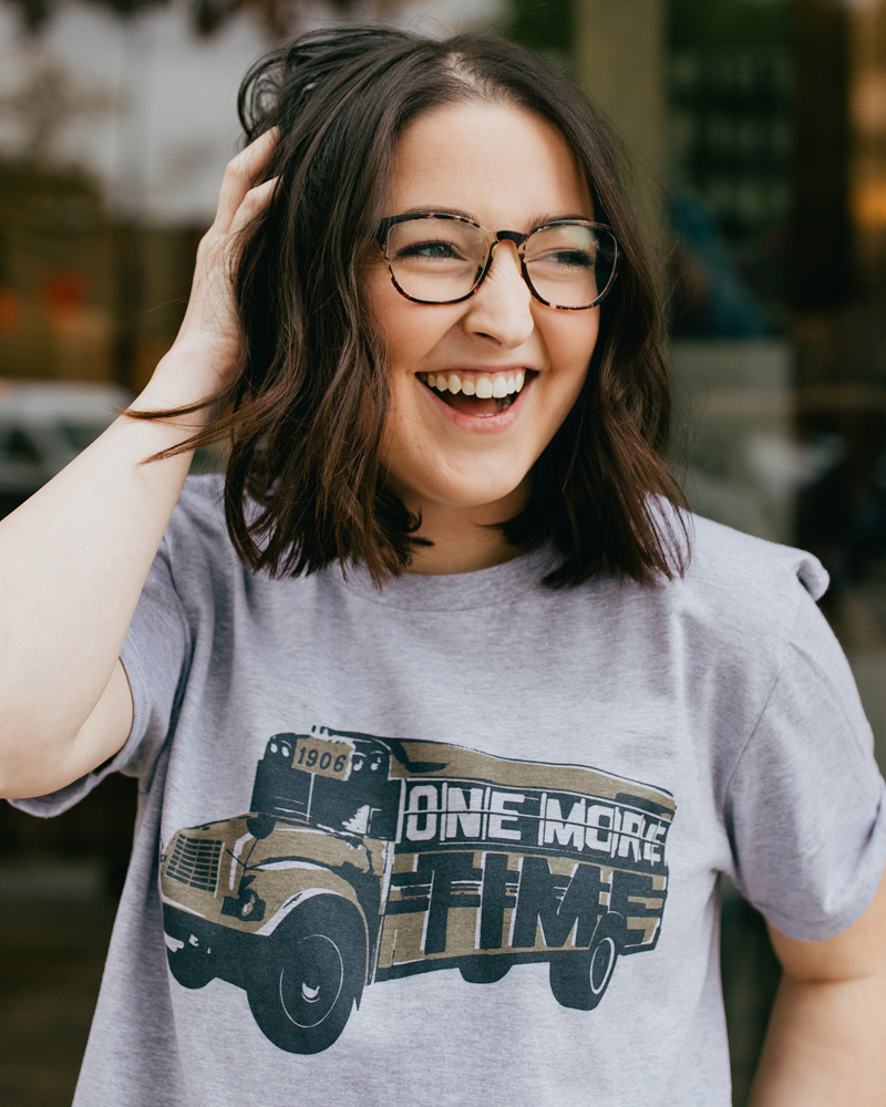 Woman laughing and wearing a gray Statesboro Georgia One More Time shirt