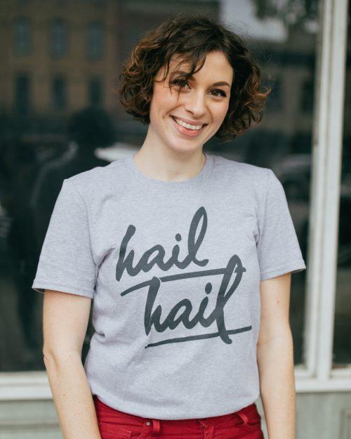 Woman wearing gray Ann Arbor Michigan Hail Hail shirt